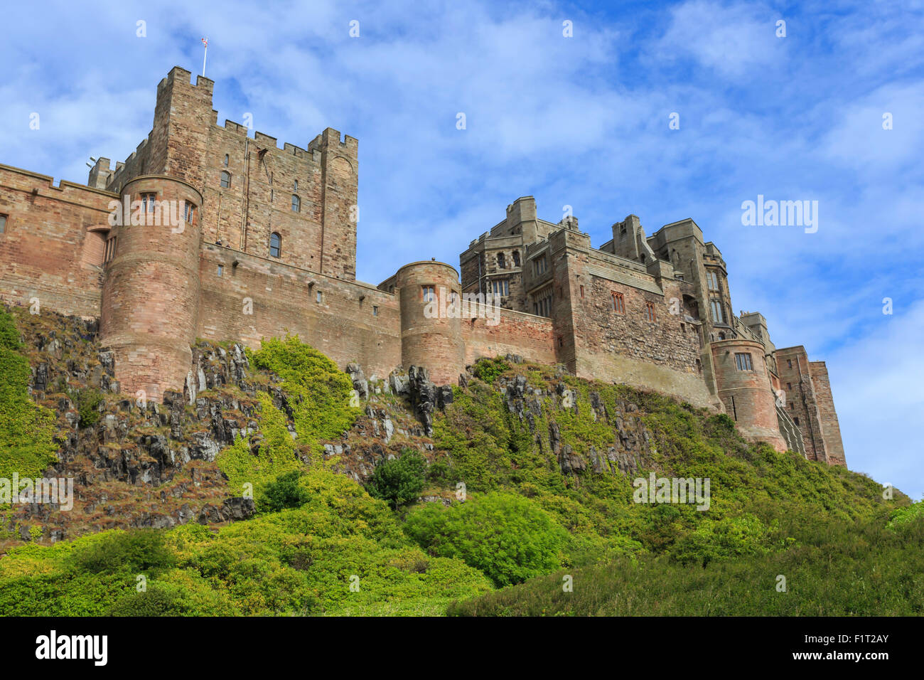 Bamburgh Cast in summer, from below, Northumberland, England, United Kingdom, Europe - Stock Image