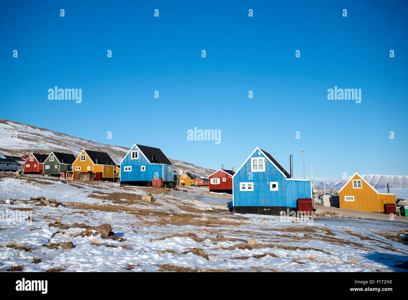 Colourful wooden houses in the village of Qaanaaq, one of the most northerly human settlements on the planet, Greenland, - Stock Image
