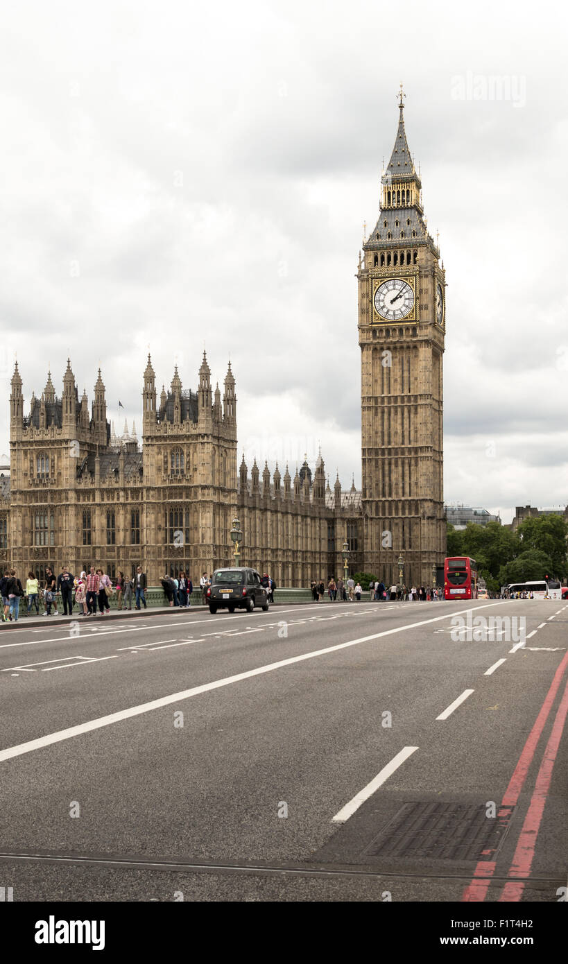 Famous London Tourist attraction Big Ben and the Houses of Parliament in England with a black cab and red bus Stock Photo