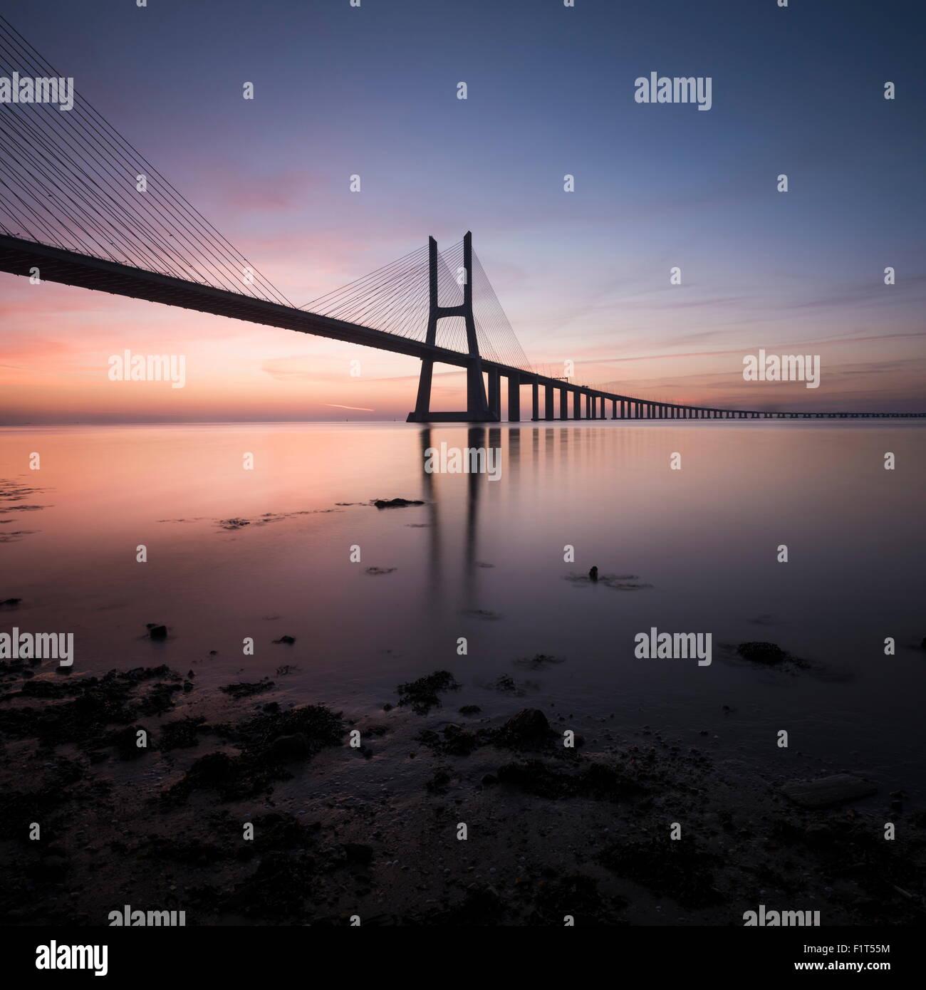 Vasco da Gama Bridge over Rio Tejo (Tagus River) at dawn, Lisbon, Portugal, Europe - Stock Image
