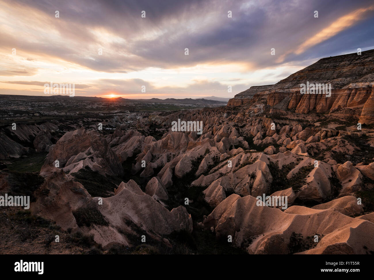 View from Aktepe Hill at sunset over Red Valley, Goreme National Park, UNESCO, Cappadocia, Anatolia, Turkey, Asia - Stock Image