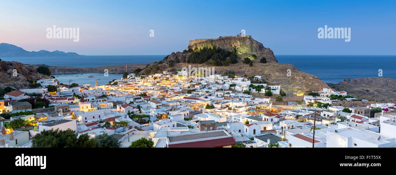 White rooftops of Lindos with the Acropolis of Lindos, Rhodes, Dodecanese, Greek Islands, Greece, Europe - Stock Image
