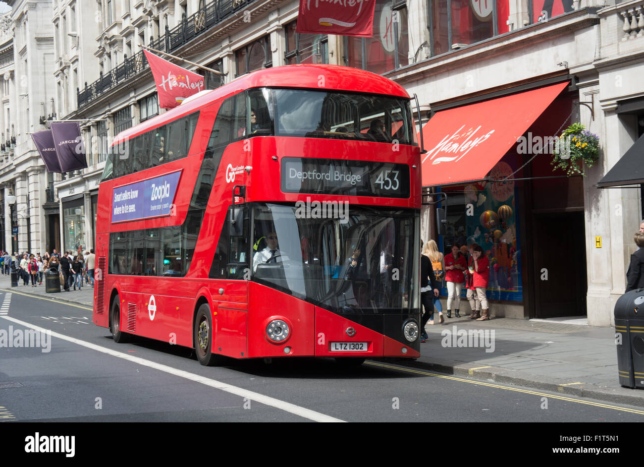A New Routemaster operated by Go-Ahead London on behalf of Transport for London on route 453 passes Hamleys toy - Stock Image