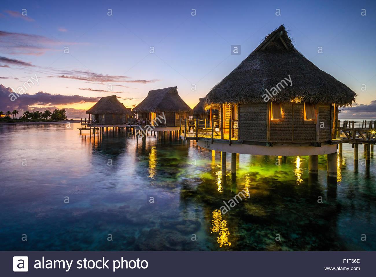French Polynesia : Tikehau Pearl Beach water bungalows at sunset - Stock Image