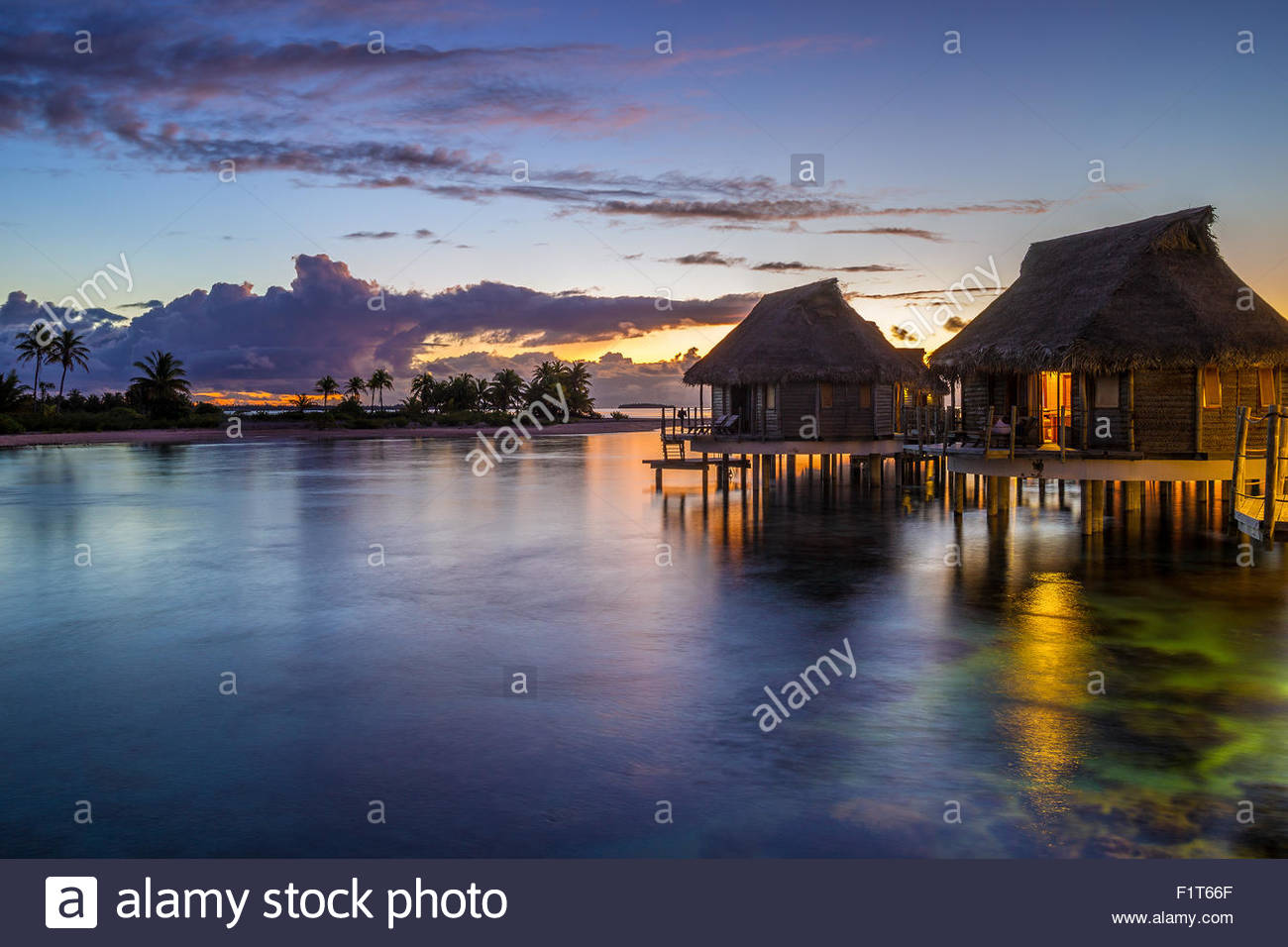 French Polynesia : Tikehau Pearl Beach water bungalows at sunset Stock Photo