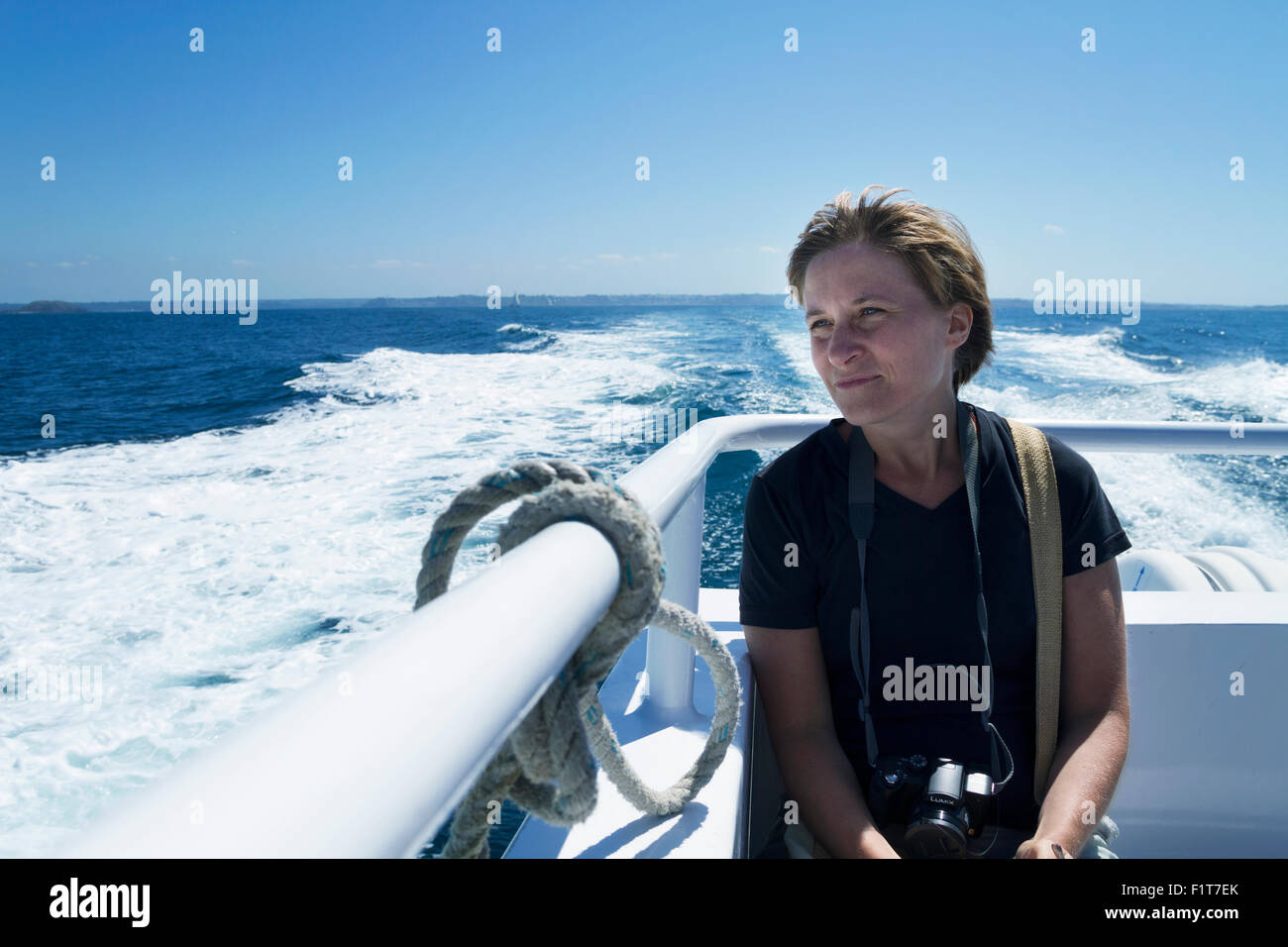 young woman 35 years caucasian in a boat - Stock Image