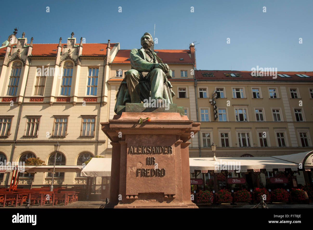 The statue of Alexander Fredro in the medieval market square of the Rynek in Wroclaw, Poland. - Stock Image