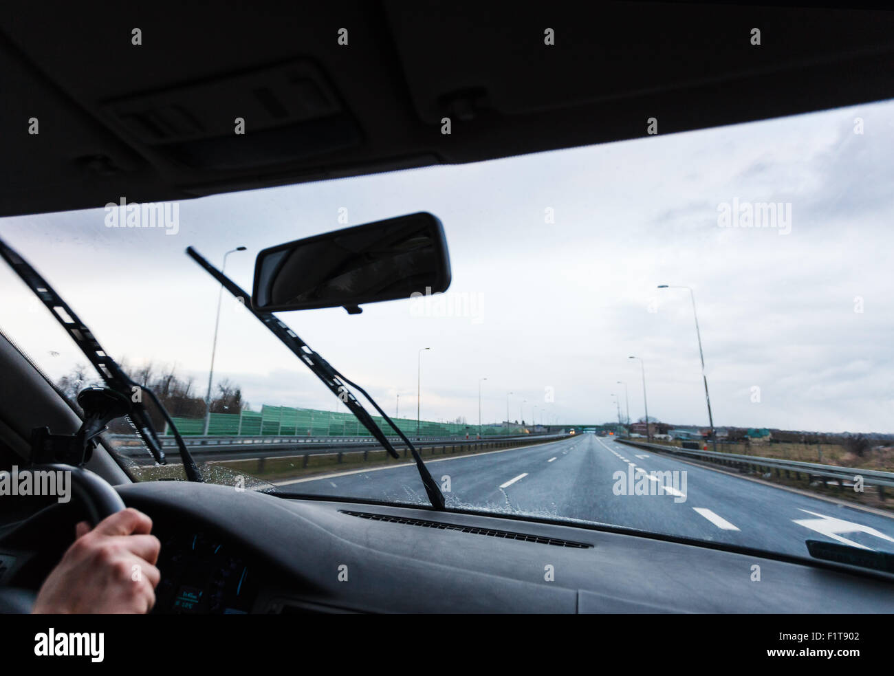 Bad weather conditions driving a car - Stock Image