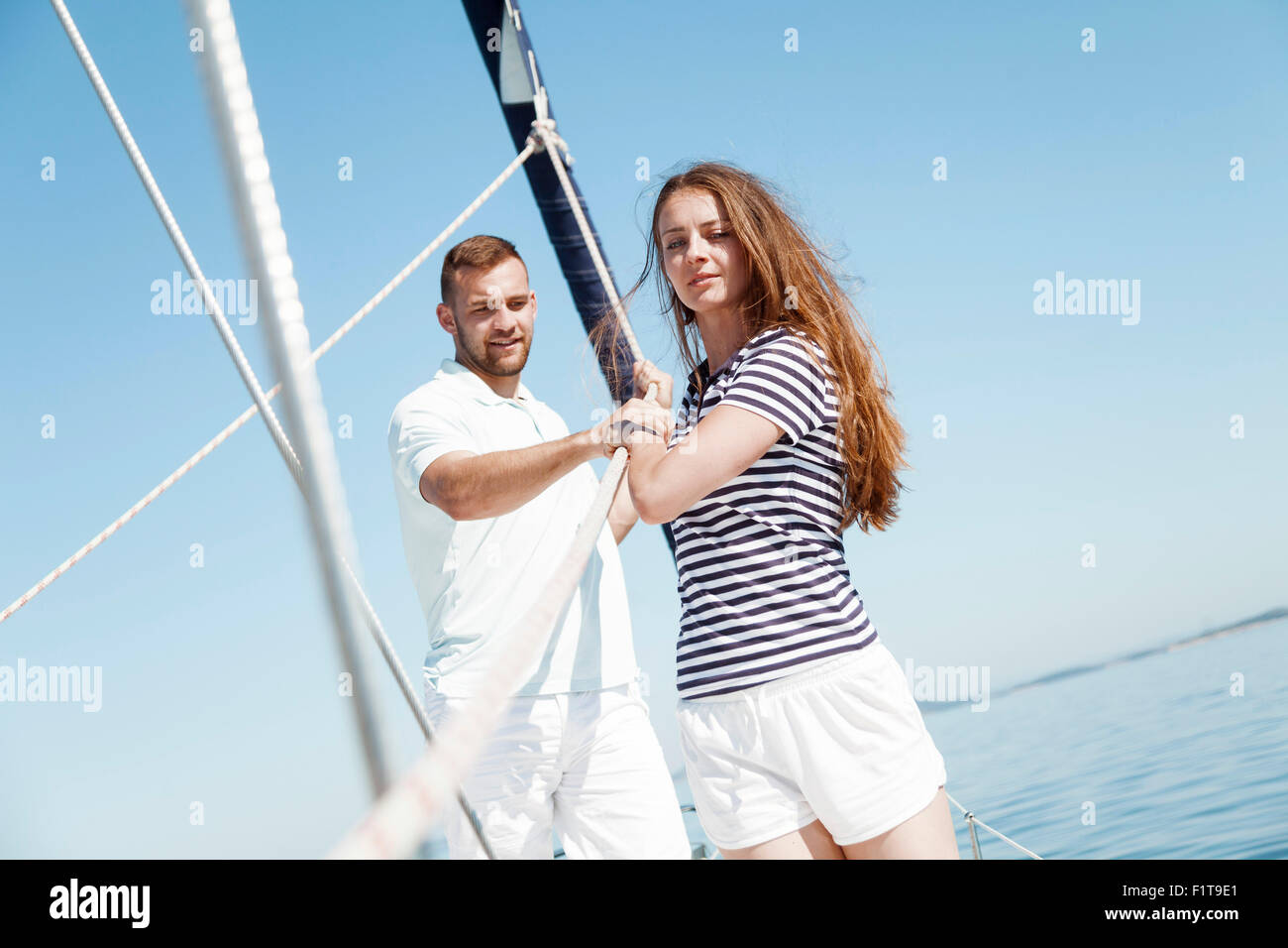 Young couple on sailboat, Adriatic Sea - Stock Image