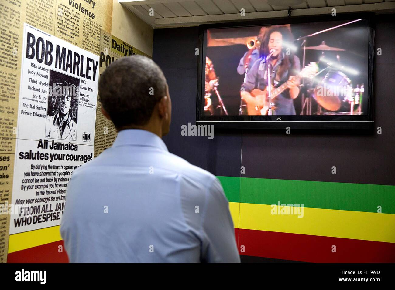 U.S. President Barack Obama watches a video during a visit to the Bob Marley Museum April 8, 2015 in Kingston, Jamaica. - Stock Image