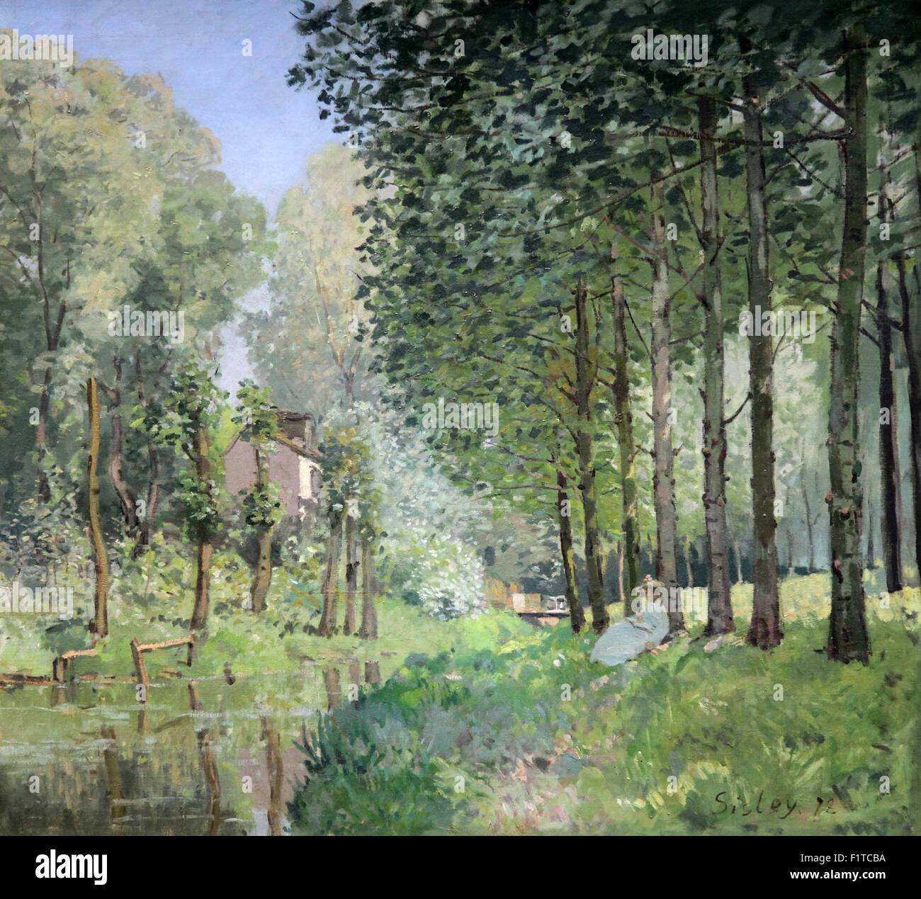 The Rest by the Stream.edge of the wood.Le repos au bord du ruisseau.Lisière de bois 1878 Alfred Sisley 1839 - Stock Image