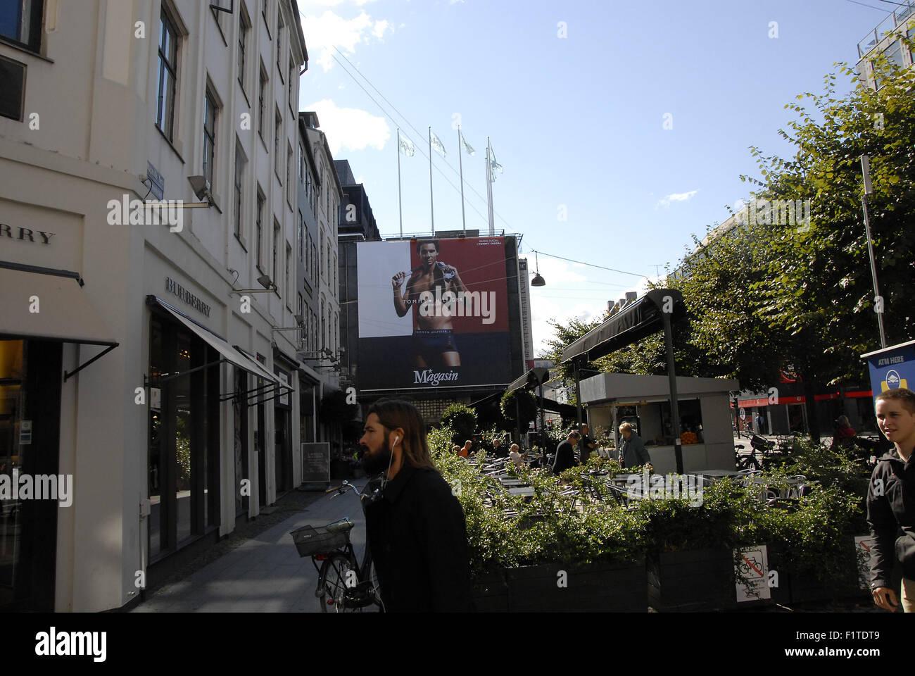 Copenhagen, Denmark. 07 September, 2015. Billboards promotion of Tommy Hilfiger hangs at Magasin du Nord department - Stock Image