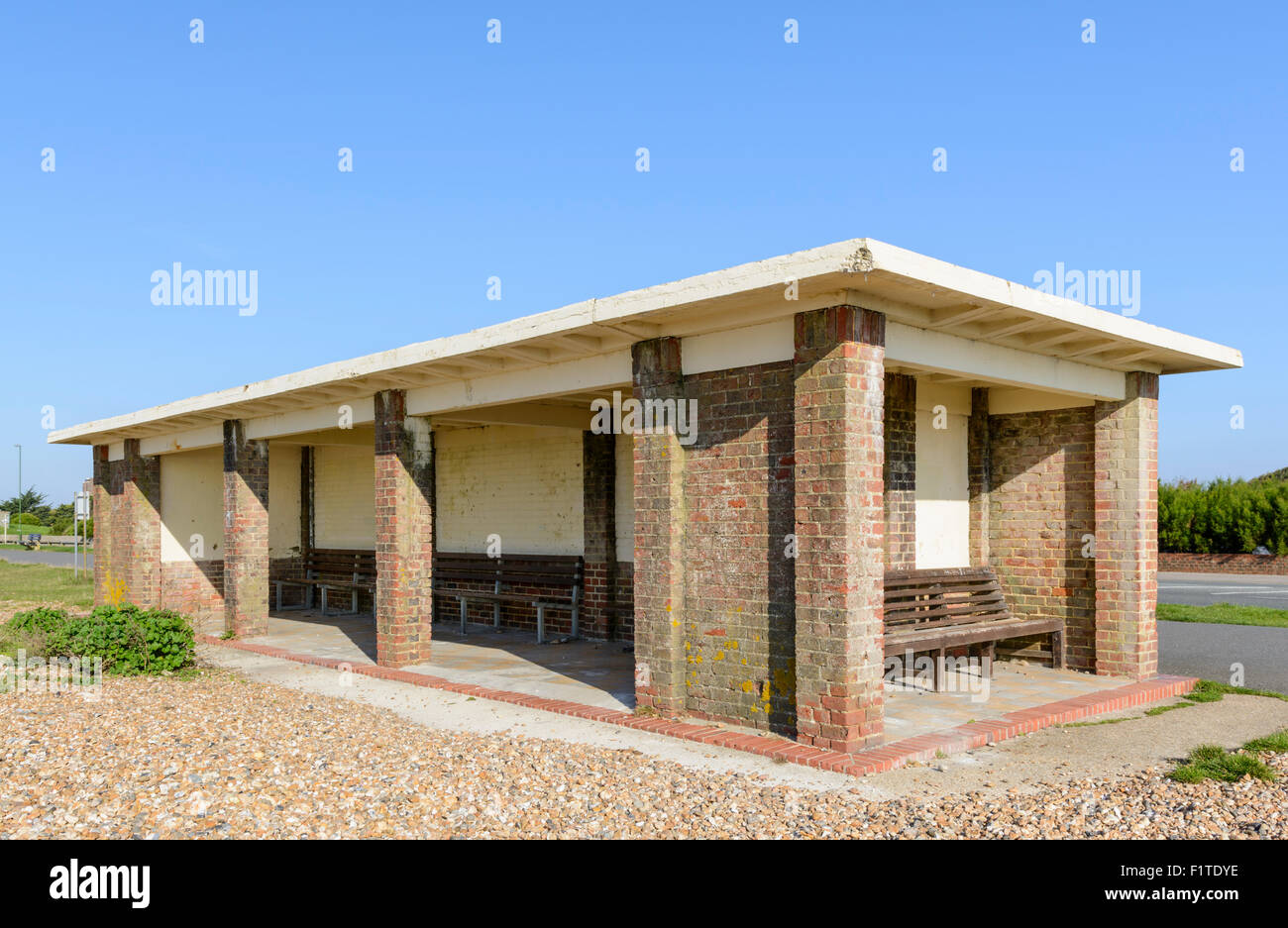 Brick shelter along the promenade by the seafront in Littlehampton, West Sussex, England, UK. - Stock Image