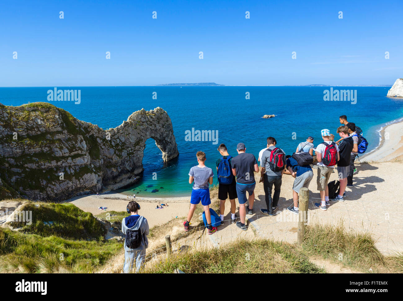 Party of school students on a field trip to Durdle Door, near Lulworth, Jurassic Coast, Dorset, England, UK - Stock Image
