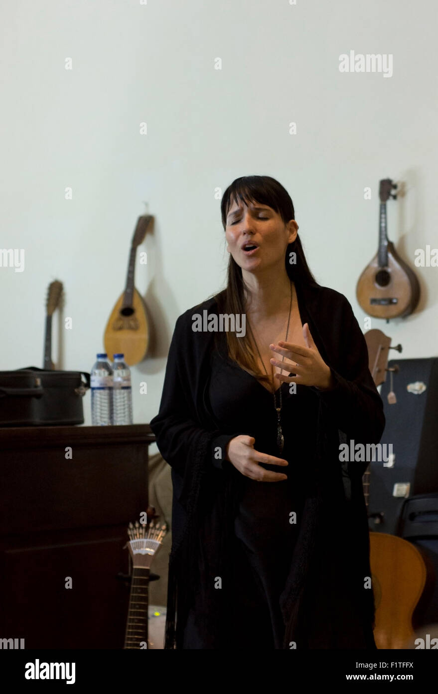 A woman sings Fado, Portugal's traditional music genre. - Stock Image