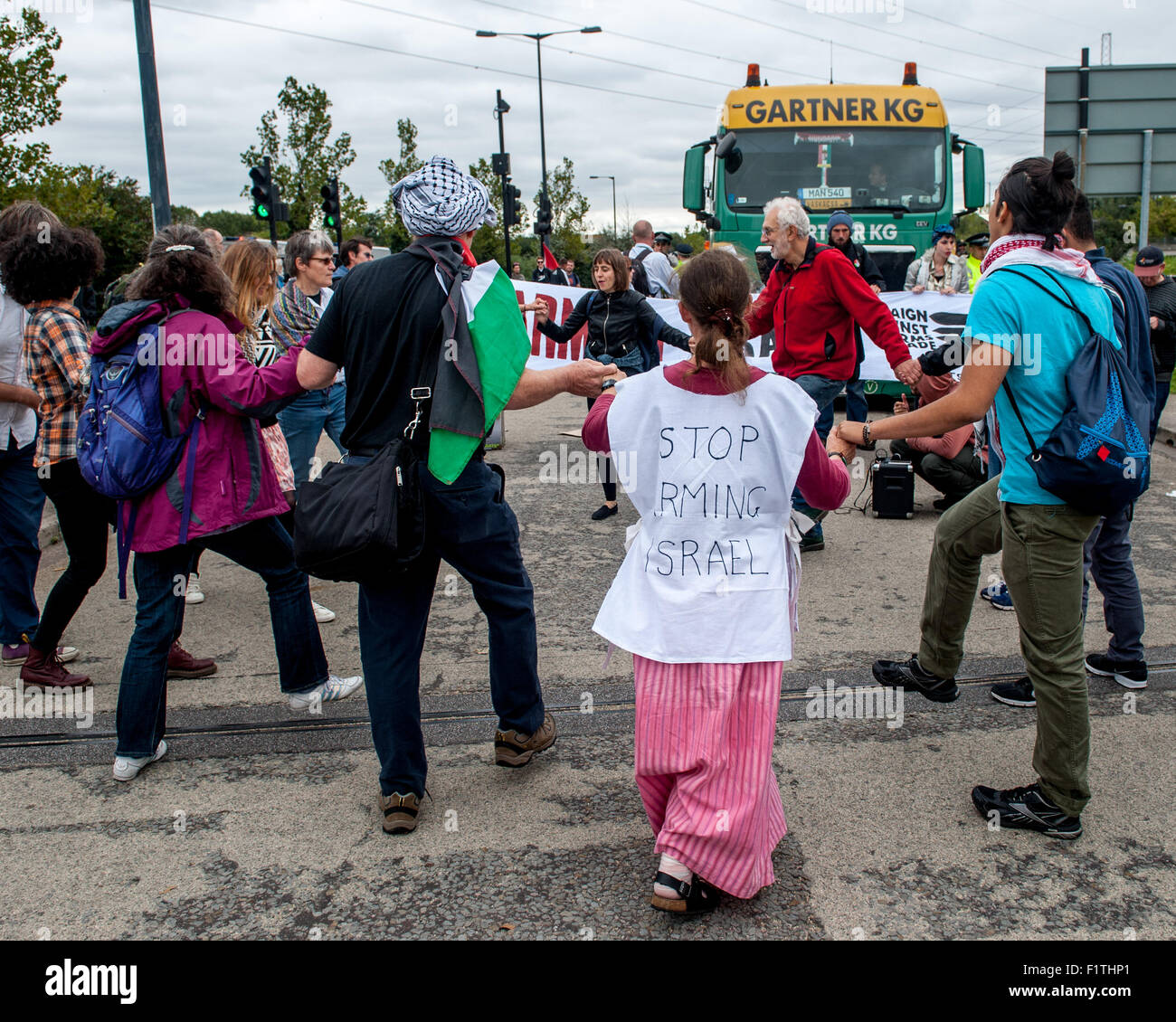 London, UK. 7th September, 2015. Activists block the delivery of a military vehicle during a protest against the Stock Photo