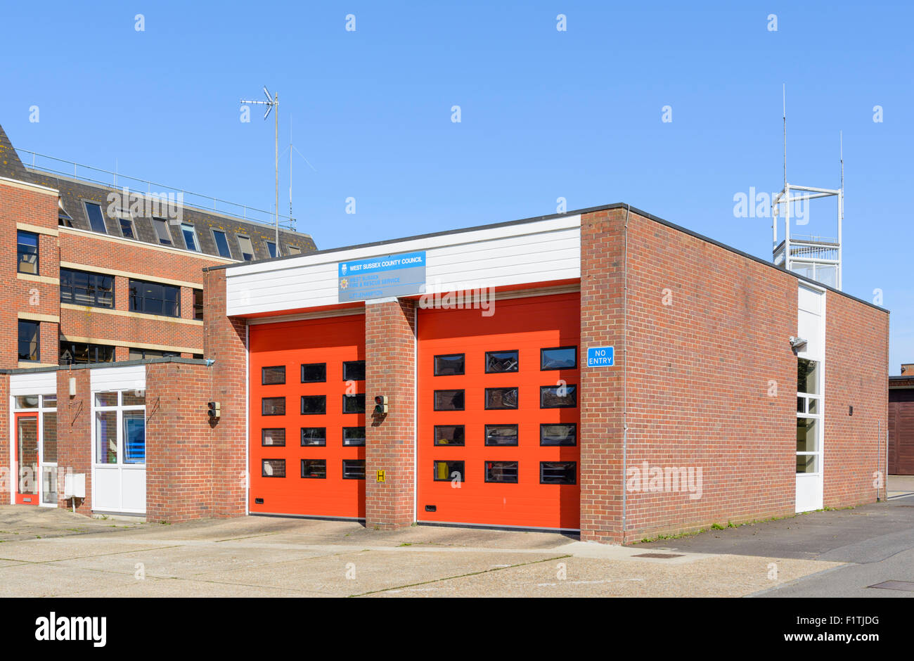 Fire Station with closed doors at Littlehampton, West Sussex, England, UK. - Stock Image