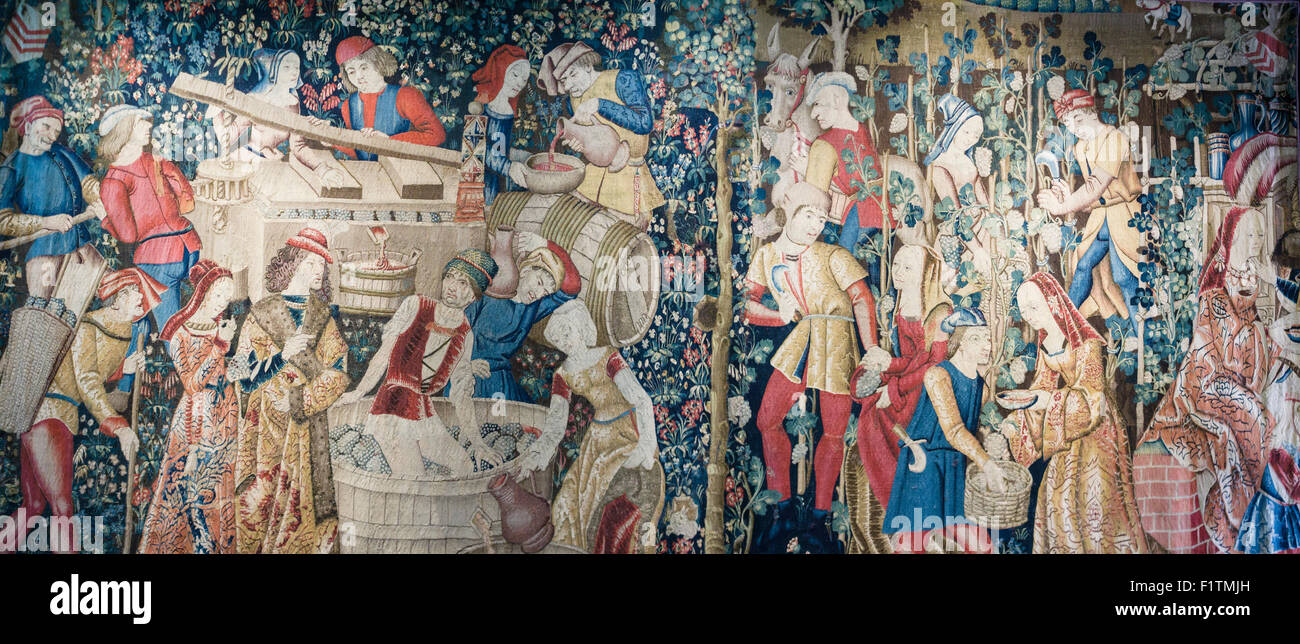 Wine Production Tapestry. A detailed medieval tapestry documenting all the steps that go into making wine. Stock Photo