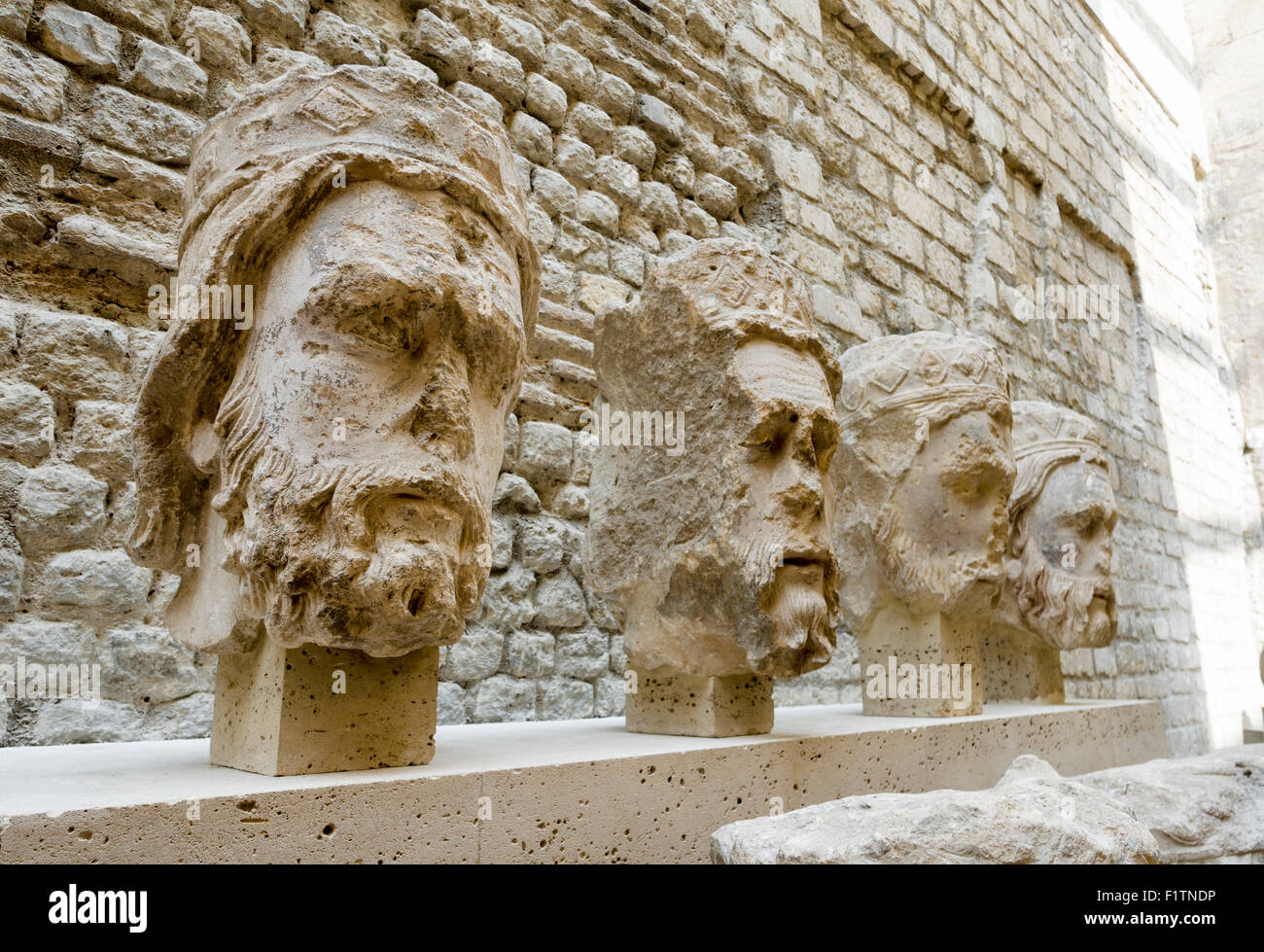 Four French Kings Sculpted Heads. Sculptures of French Kings heads from 1220 originally from the front of Notre - Stock Image