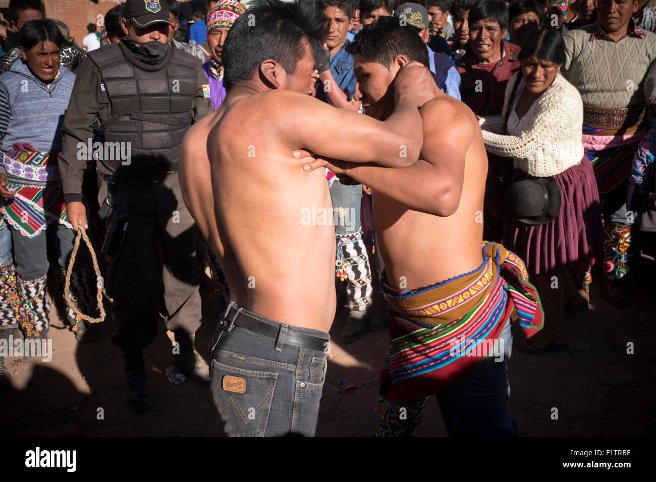 During the celebration of Tinku, fights start among the attendees, either individually or in a group fighting. - Stock Image