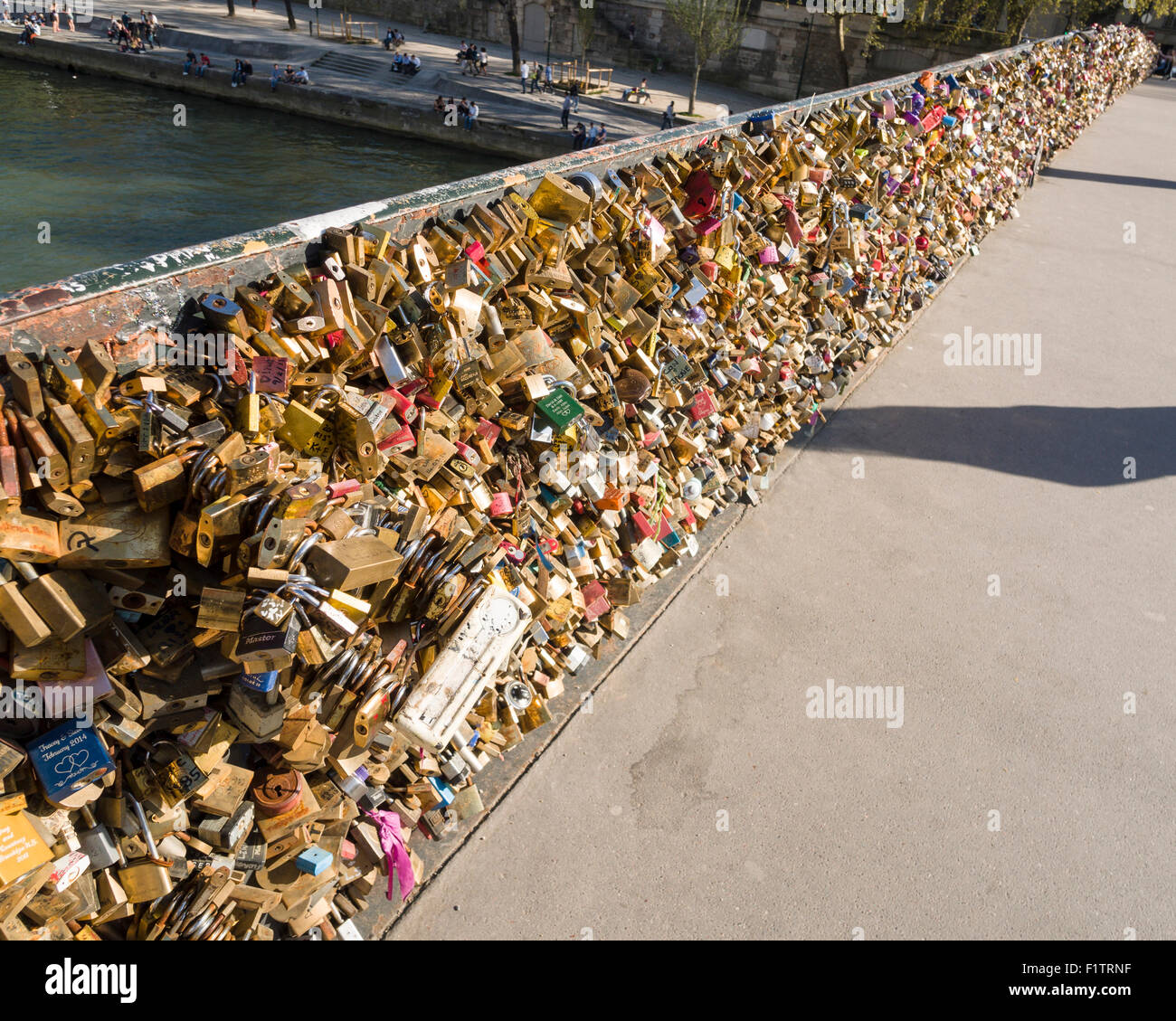 Locks over the Seine. Thousands of locks fill the sides of the bridge over the famous river. - Stock Image