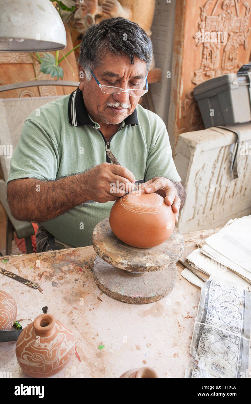 Señor Mena decorates pottery via etching. An artisan etches pottery using old Mayan patterns.  A photocopy - Stock Image