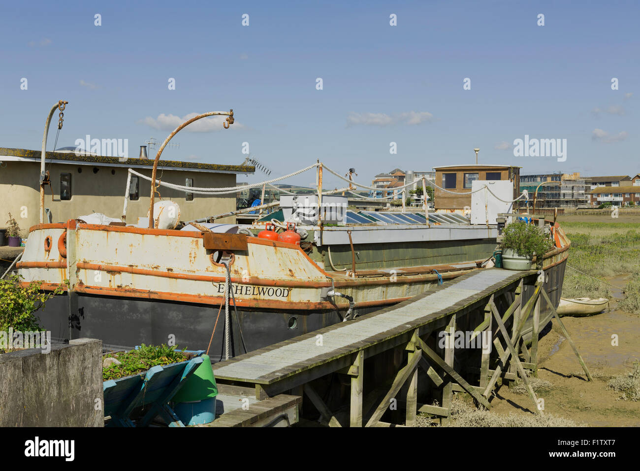 Houseboats in Shoreham harbour West Sussex. Lifestyle living on the estuary of the river Adur. Stock Photo