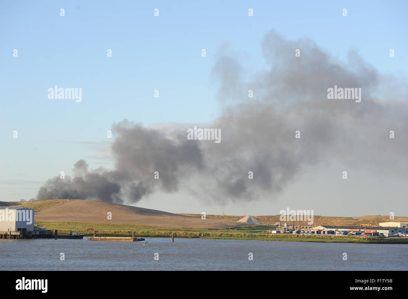 Fire seen in  Rainham  essex from Erith Kent smoke fillling the sky.  Featuring: View Where: London, United Kingdom Stock Photo