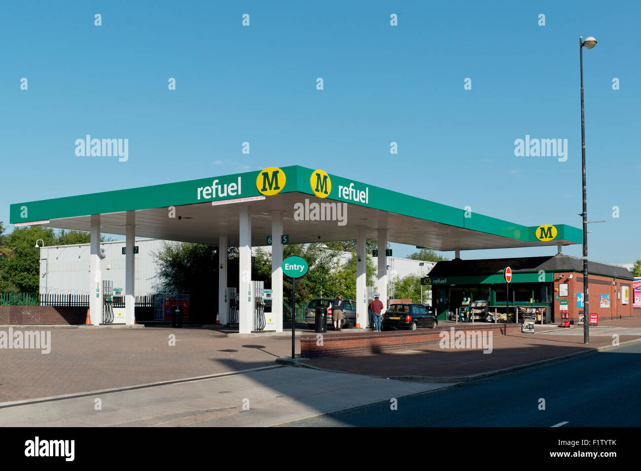 A Morrisons Refuel petrol filling station in Salford shot against a blue sky (Editorial use only). - Stock Image