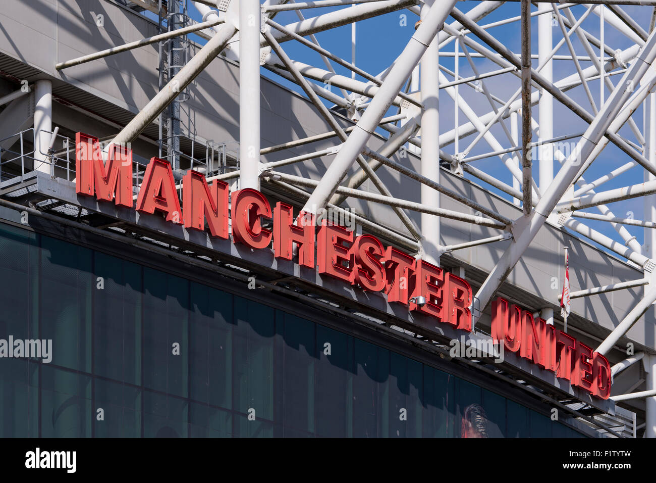 The sign of Manchester United Football Club on the side of the club's stadium of Old Trafford (Editorial use - Stock Image