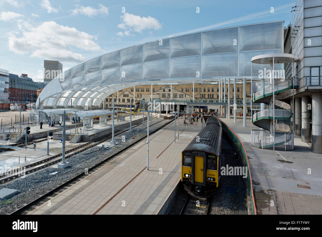 The refurbished Victoria Station in Manchester, as a Northern Rail train emerges - Stock Image