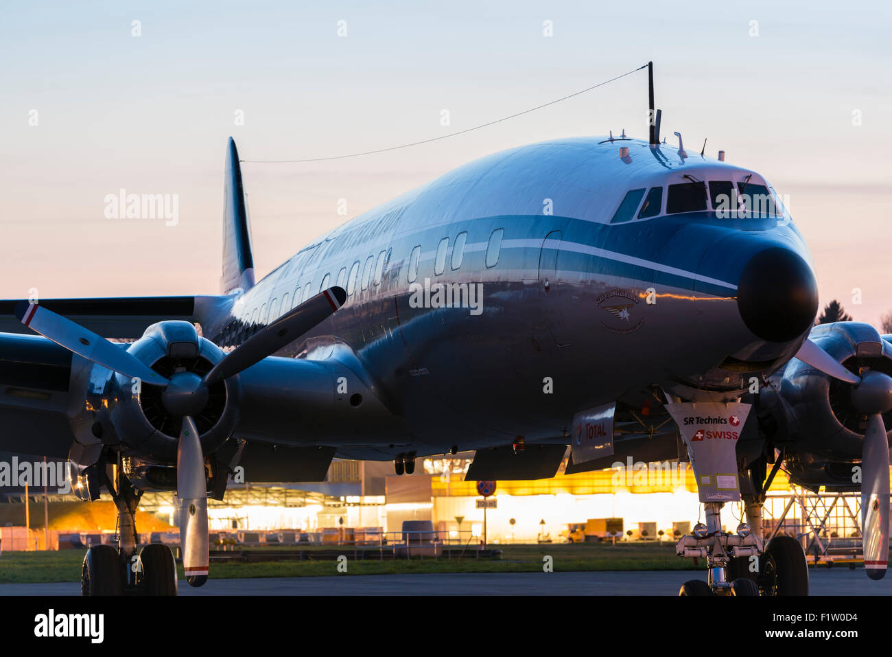 "Classic vintage aircraft Lockheed L-1049 Super Constellation ""HB-RSC"" in  the evening twilight at Zurich Kloten airport."