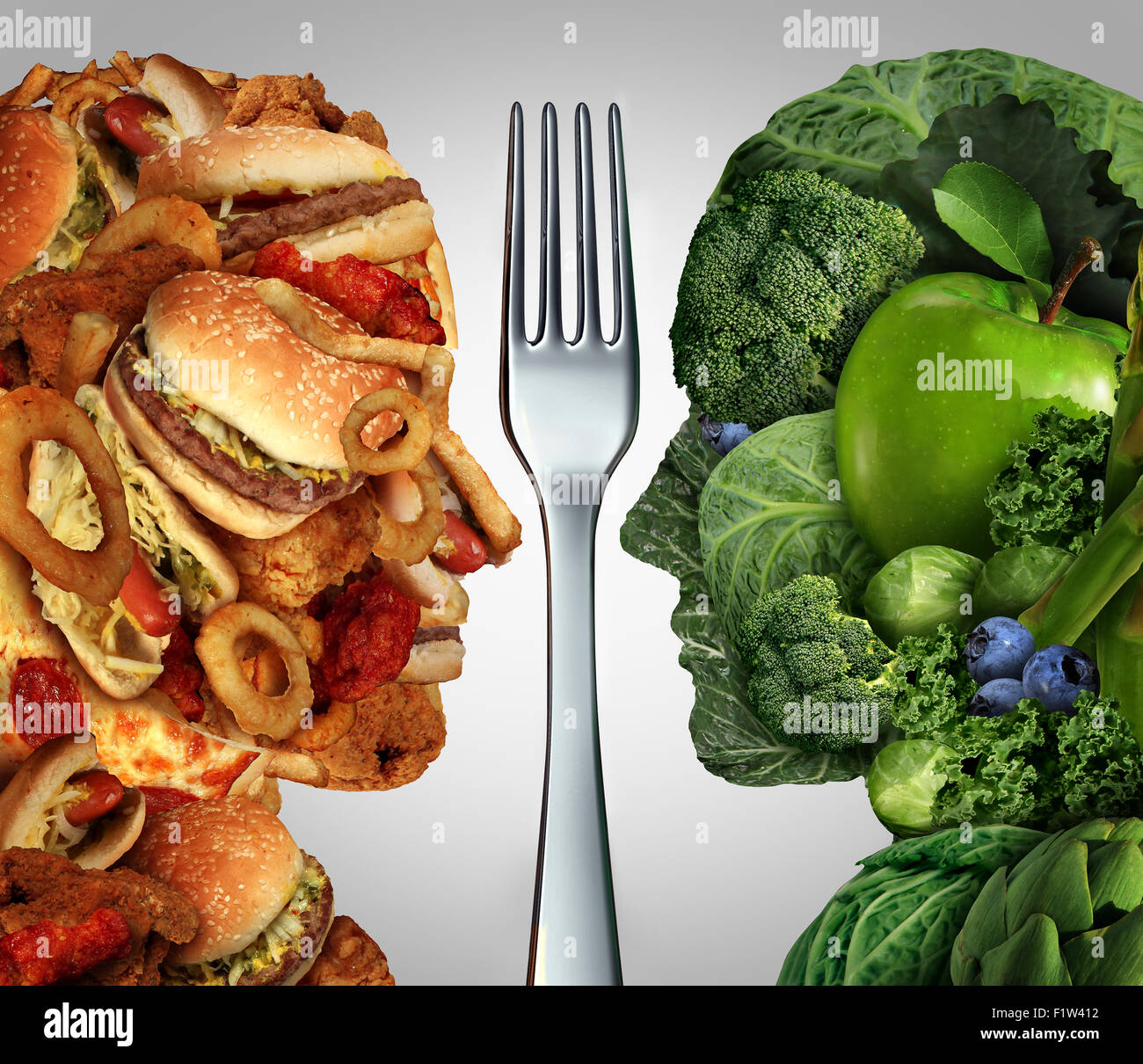 Nutrition decision concept and diet choices dilemma between healthy good fresh fruit and vegetables or greasy cholesterol - Stock Image