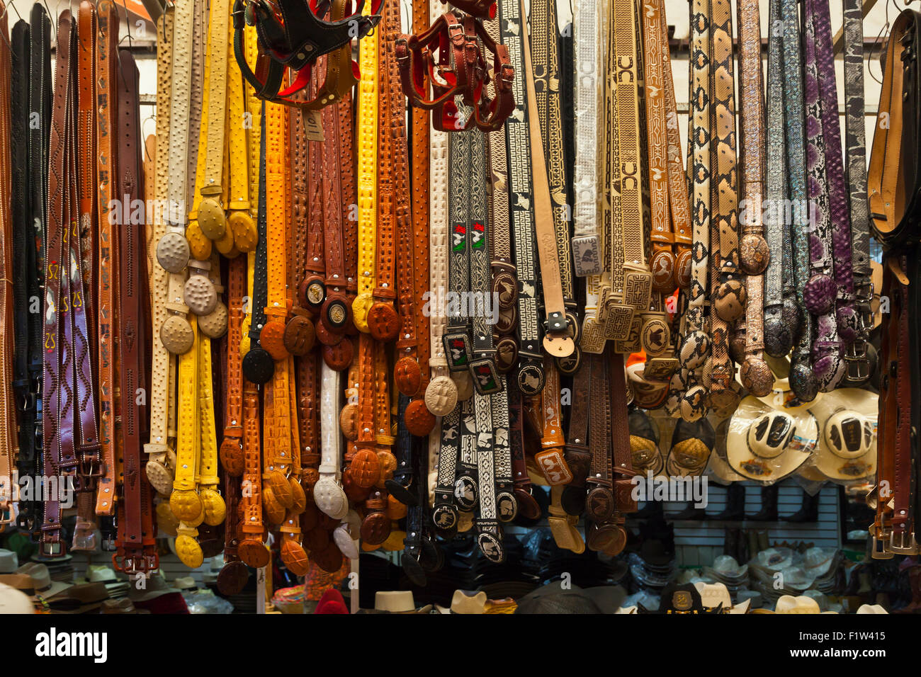 BELTS made from animal skins and for sale in the massive MERCADO DE ABASTOS - OAXACA, MEXICO - Stock Image