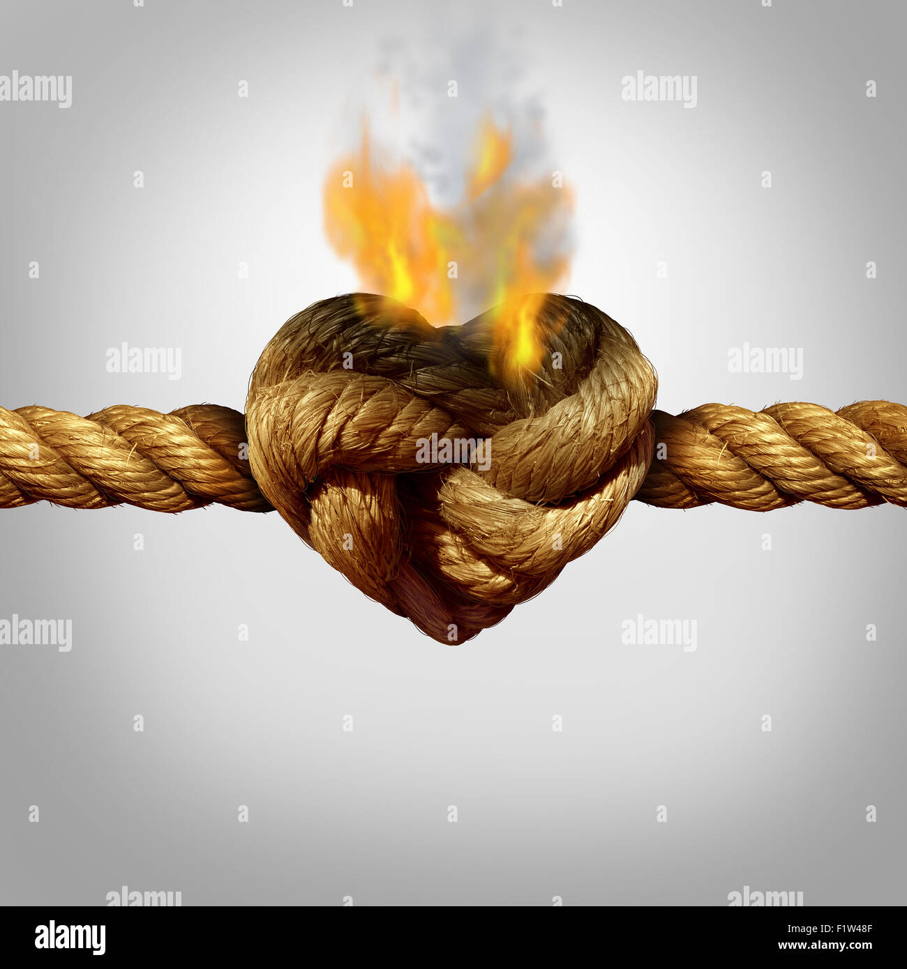 Divorce and separation concept as a rope with a burning knot shaped as a love heart as a relationship problem symbol - Stock Image