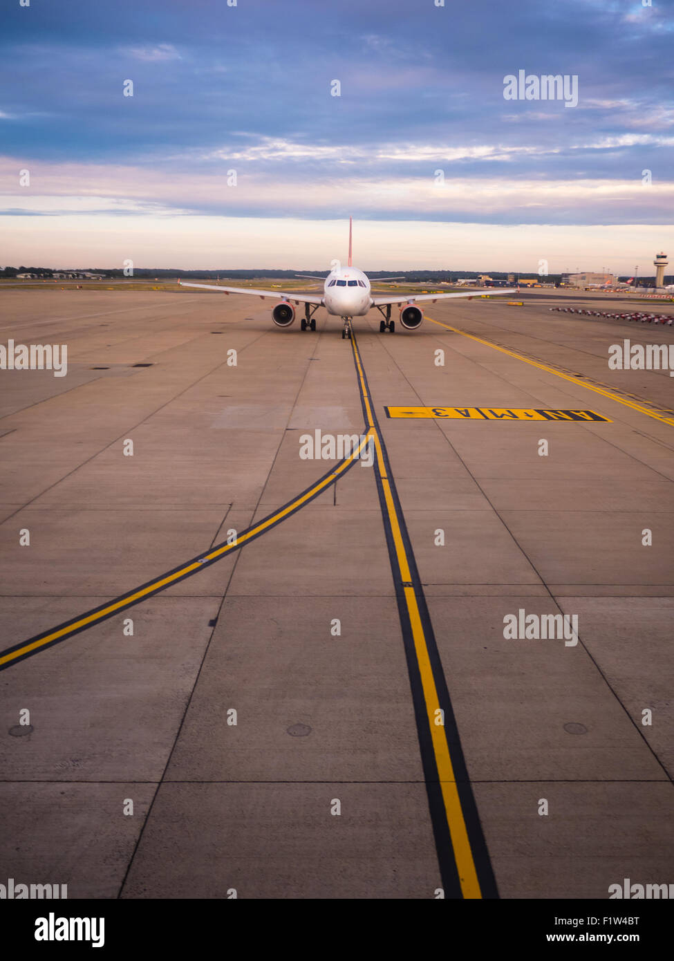 An Easyjet aircraft taxying to the Runway of Gatwick Airport, London, England - Stock Image