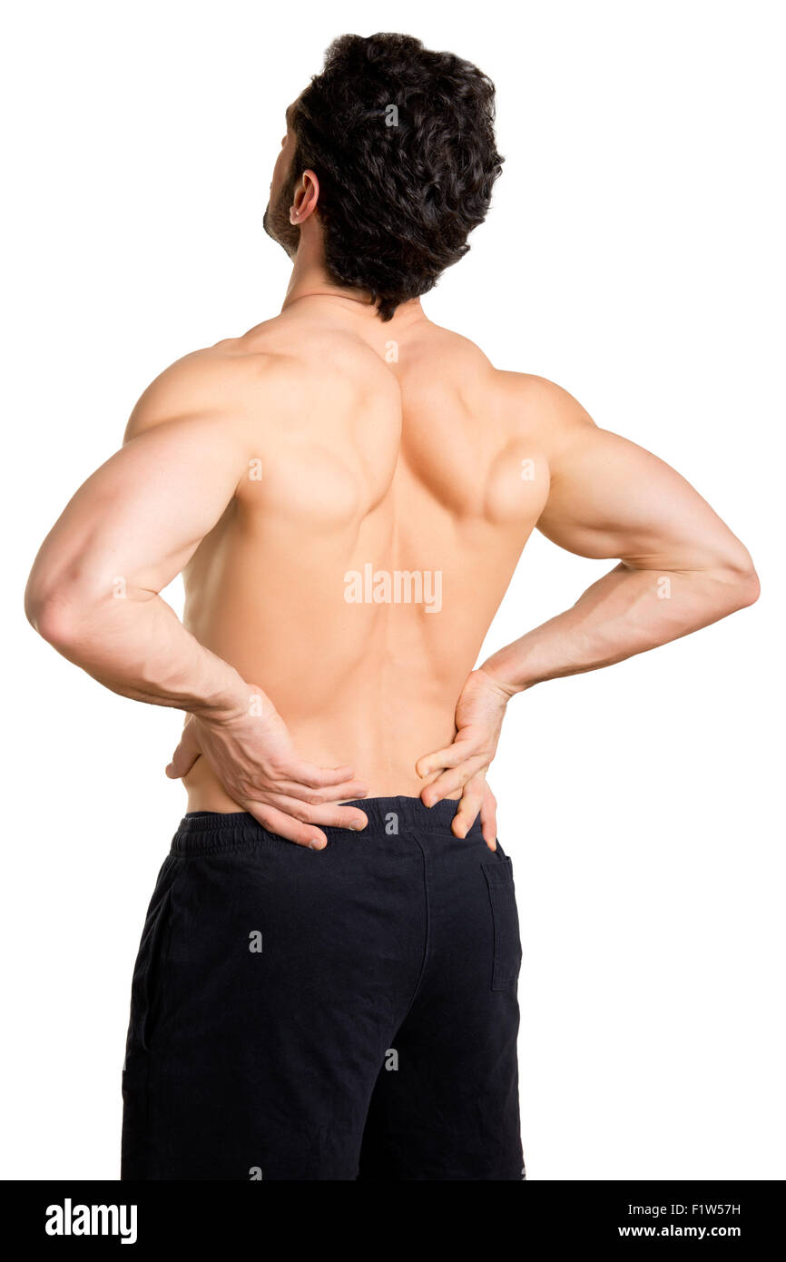 Male athlete with pain in his lower back, isolated in white - Stock Image