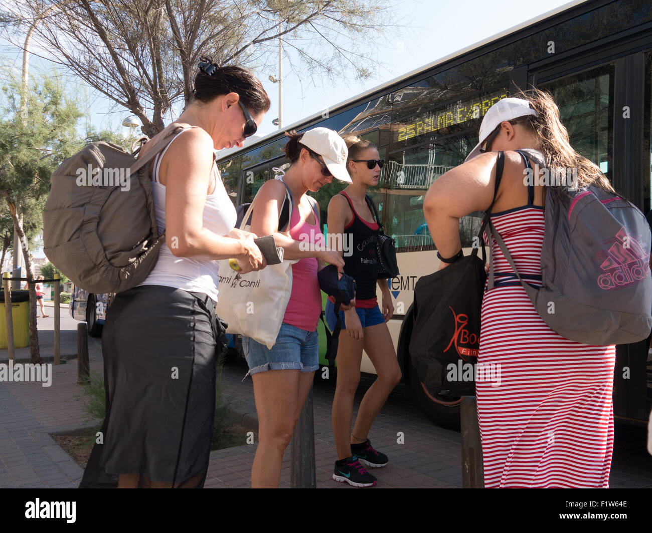 passengers waiting to board an EMT bus in El Arenal, Mallorca, Spain - Stock Image