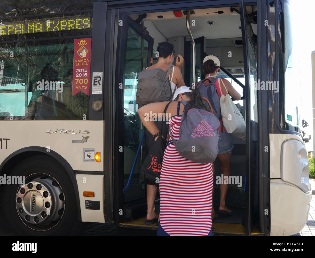 Passengers boarding the Palma express bus in El Arenal, Mallorca, Spain. - Stock Image