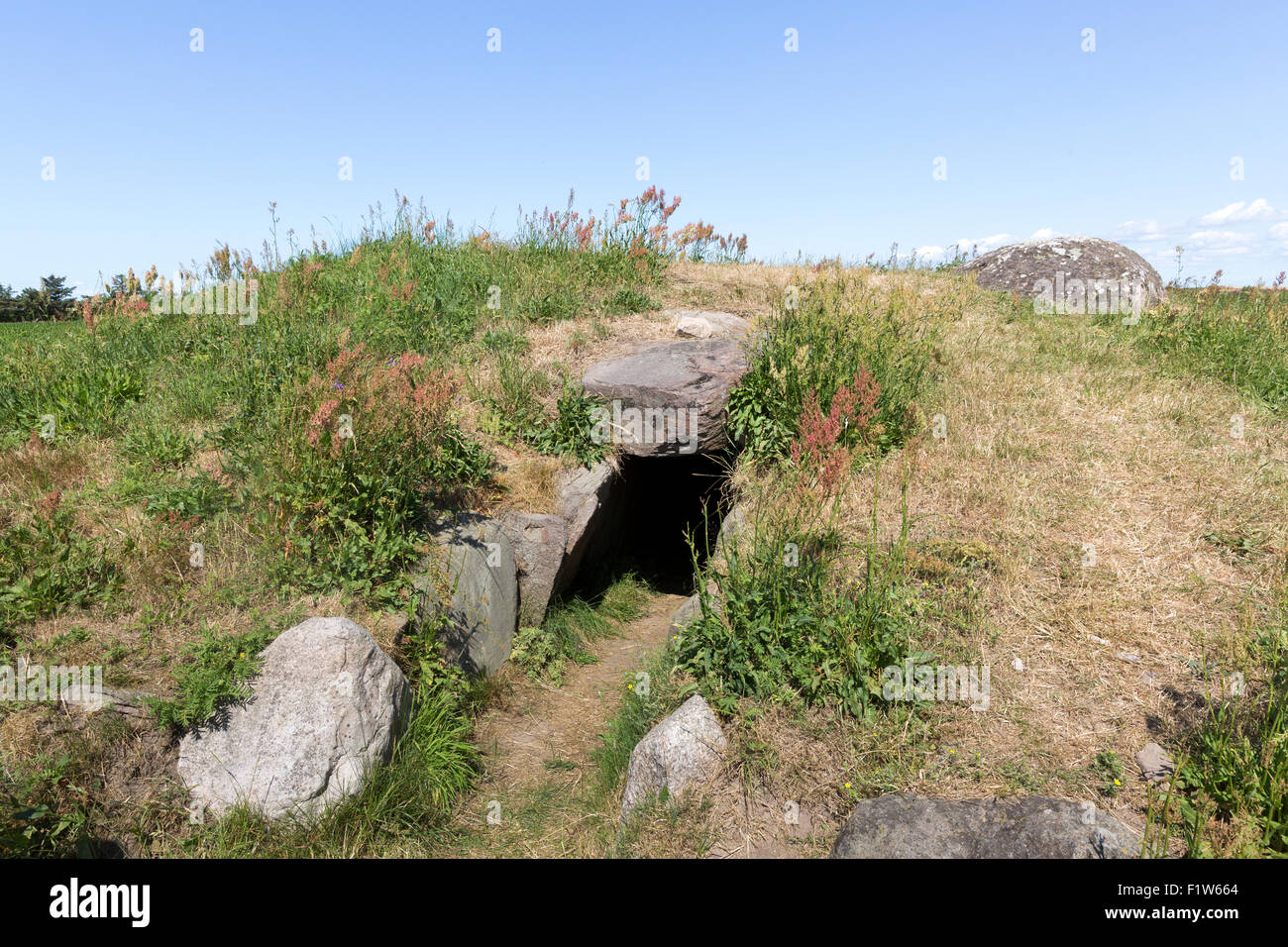 The entrance to the archaeological site of the Kragnaes Passage Cave on the island of Aero, Denmark. - Stock Image