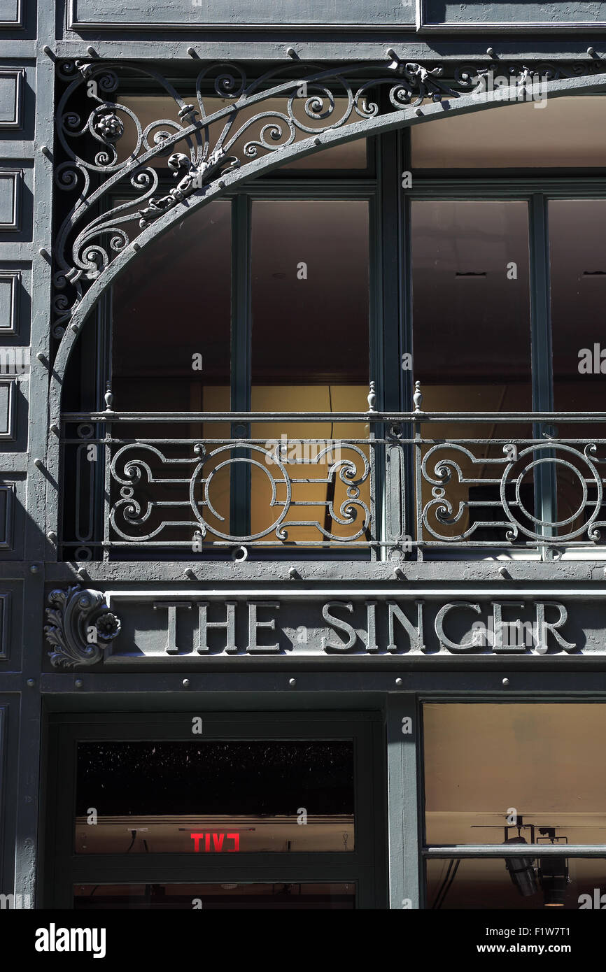 art nouveau style steel frame decorating the facade of little singer