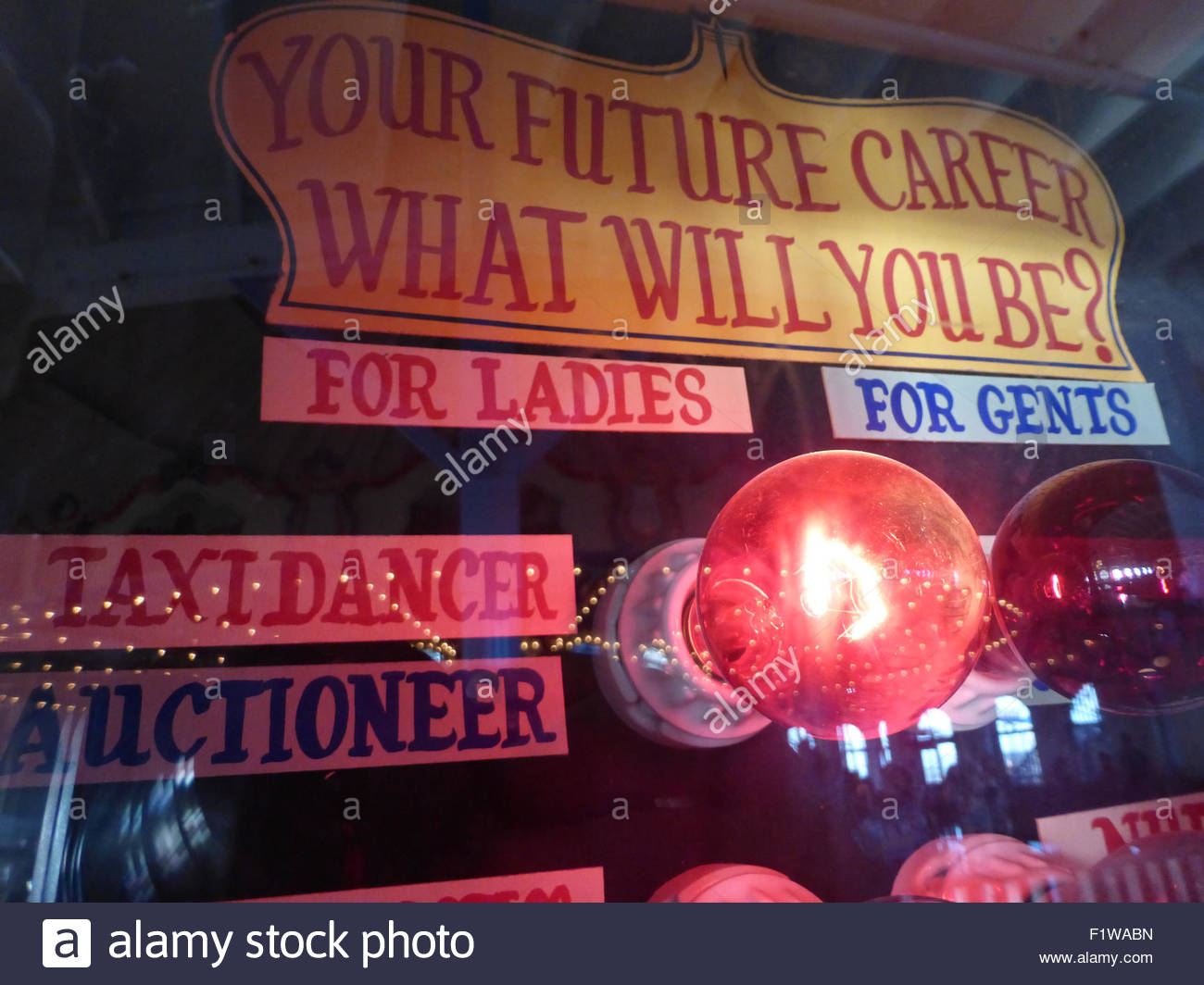 View of a vintage retro old fashioned fortune telling machine in an old arcade and game parlor on a California pier. - Stock Image