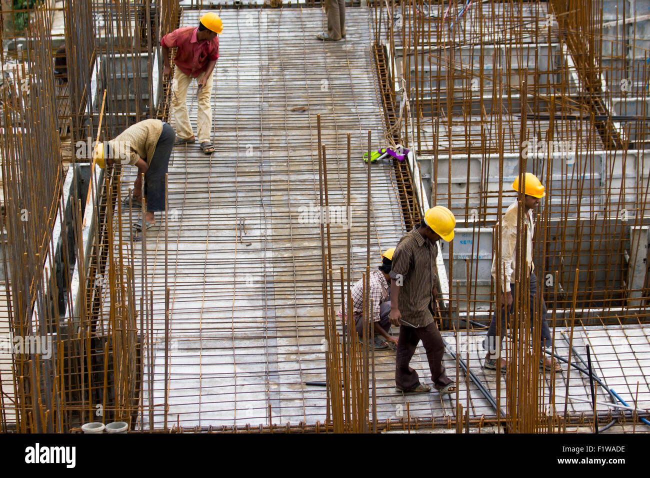 Unidentified workers are employed in construction overhead metro in Bangalore City Stock Photo