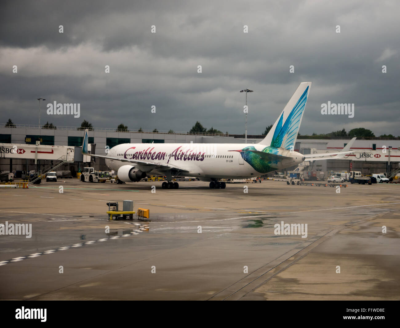 Caribbean Airlines 767, registration 9Y-LGW, at gate 48R of London Gatwick Airport, North Terminal - Stock Image