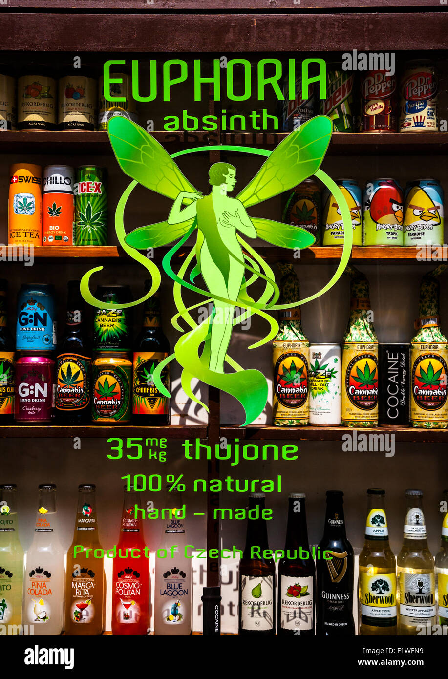 Euphoria Absinthe sign on a liquor store window with other cannabis flavoured alcoholic  drinks in the background, - Stock Image