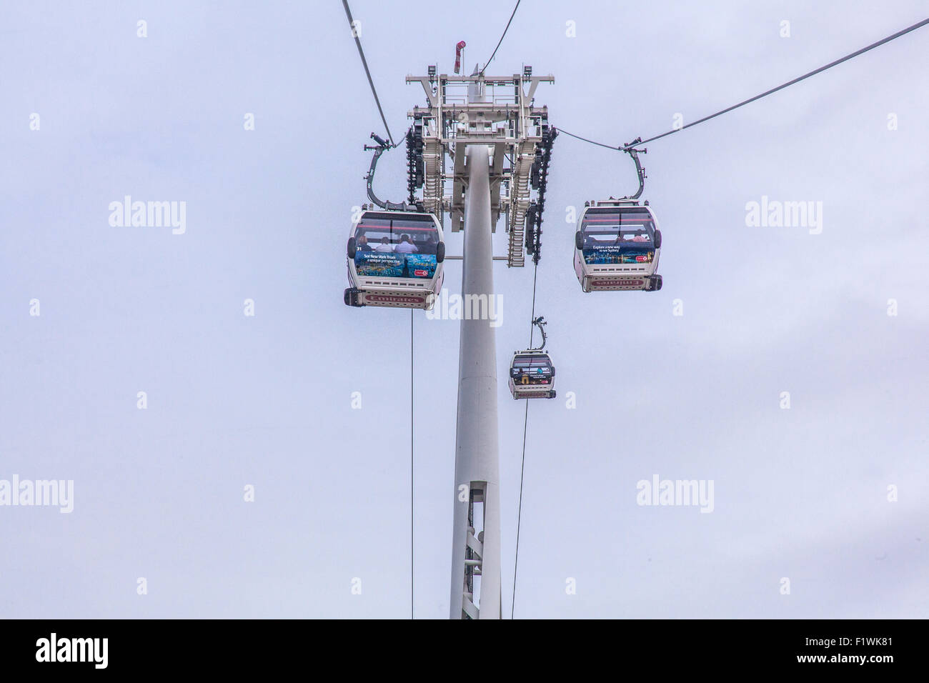 Emirates Air Line cable car crossing the River Thames from North Greenwich to Royal Victoria Dock, London, England, - Stock Image