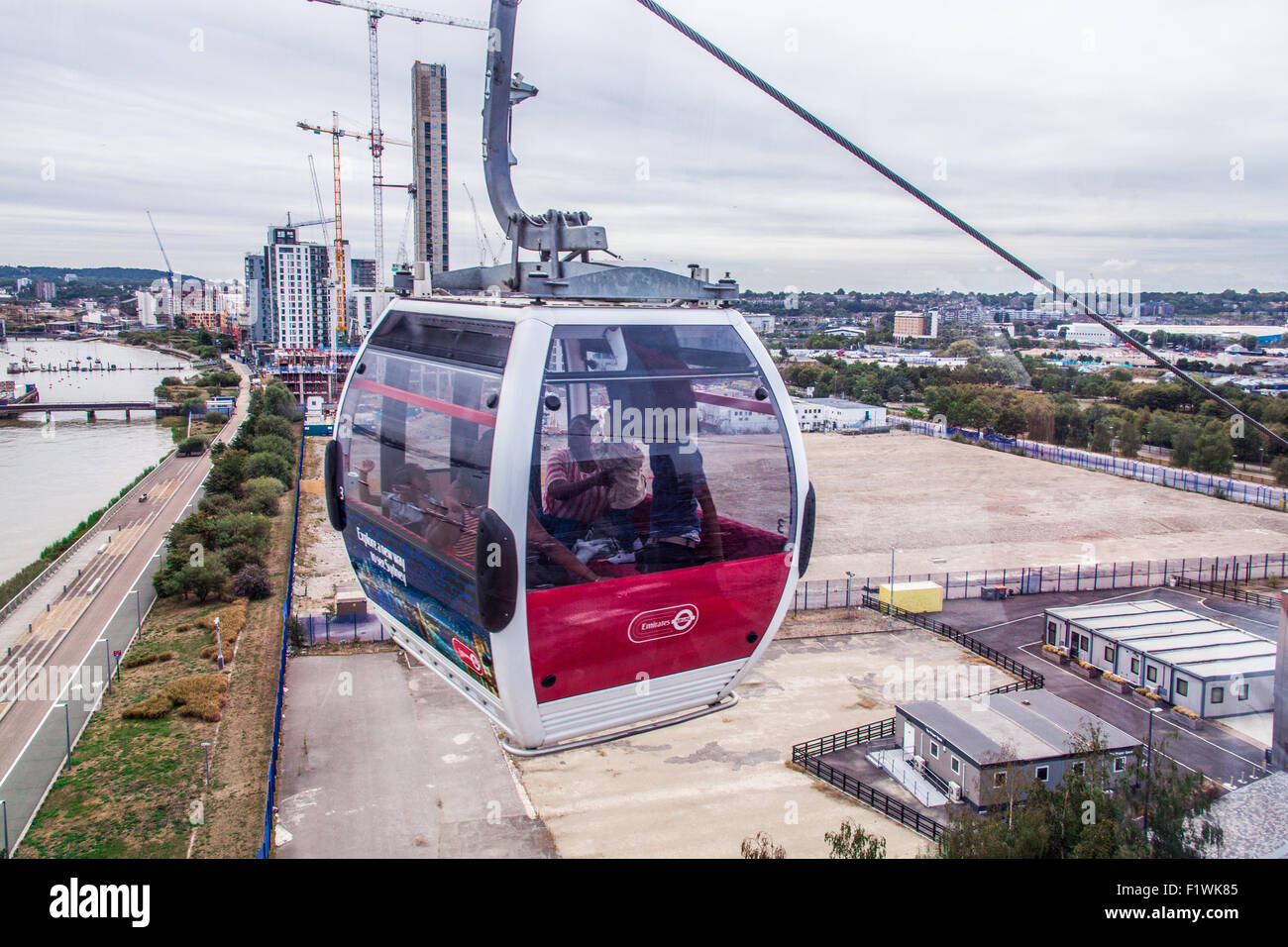Emirates Air Line cable car crossing the River Thames from North Greenwich to Royal Victoria Dock, London, England, Stock Photo