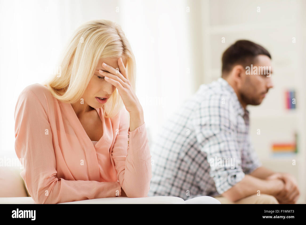 unhappy couple having argument at home - Stock Image