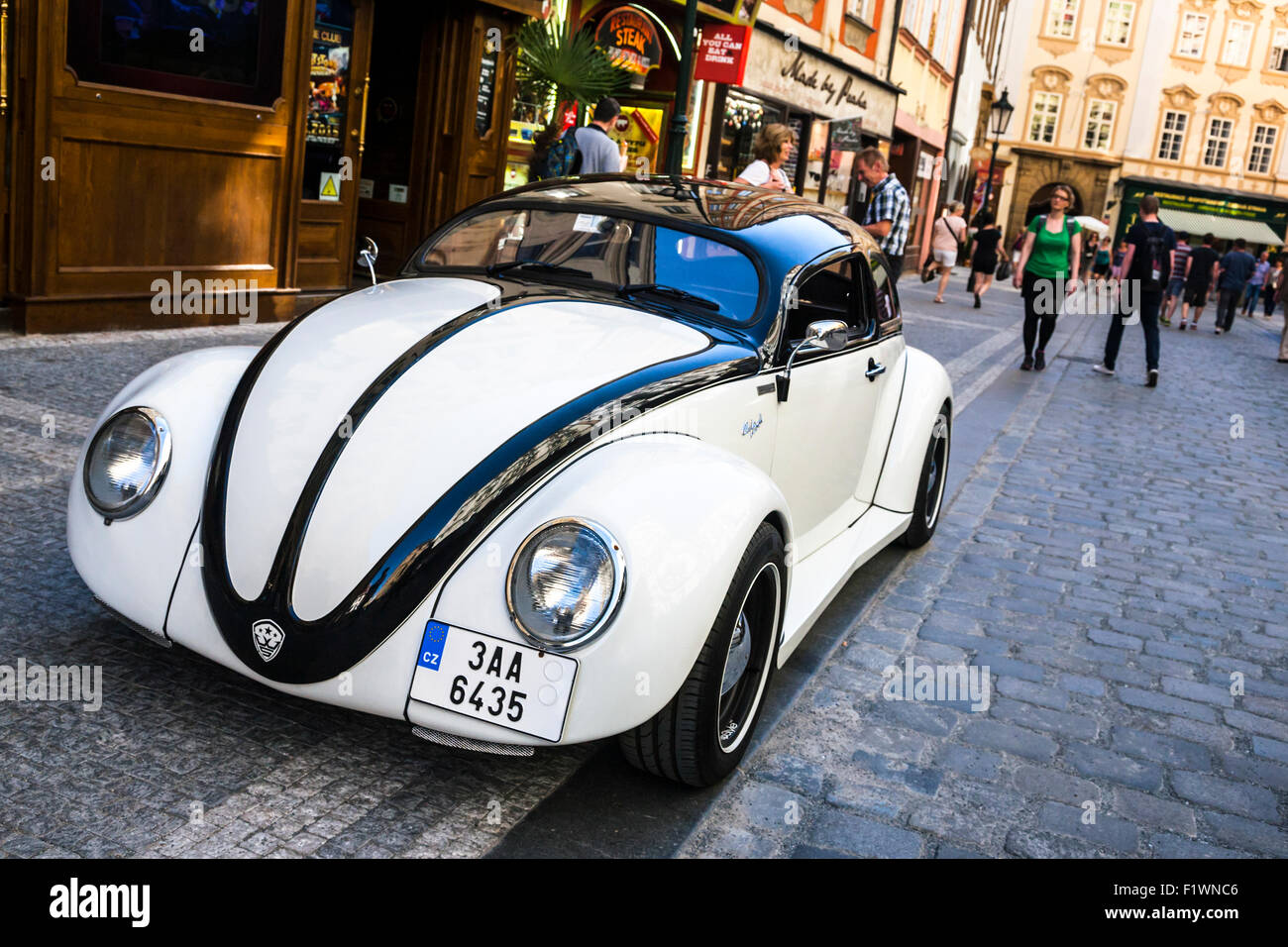 Customised old white Volkswagen Beetle parked on a Prague street, Czech Republic. Stock Photo