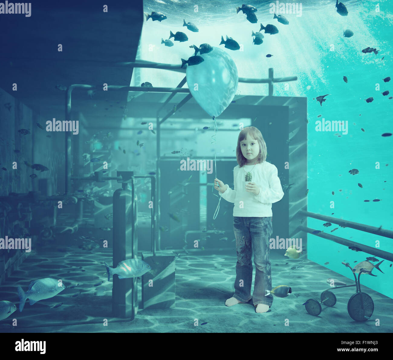 Little girl with ball underwater. CG and photo elements compilation - Stock Image